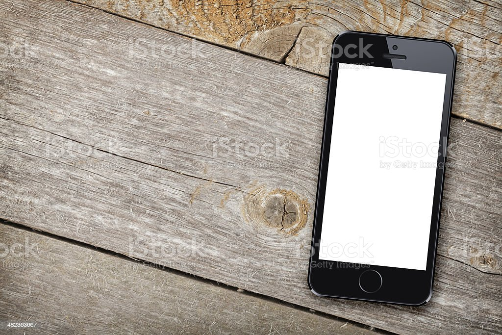 Smart phone on wooden table stock photo