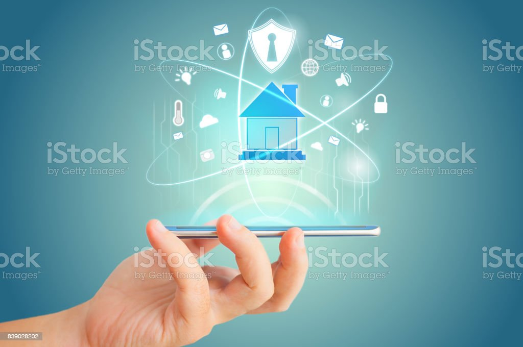 Smart phone remote for smart home hologram technology concept stock photo