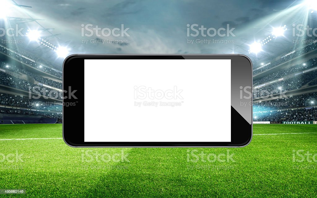 Smart phone soccer stadium scene stock photo