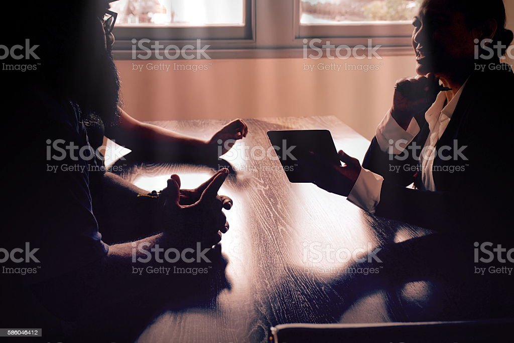 Smart Phone Technology in Small Business Meeting stock photo