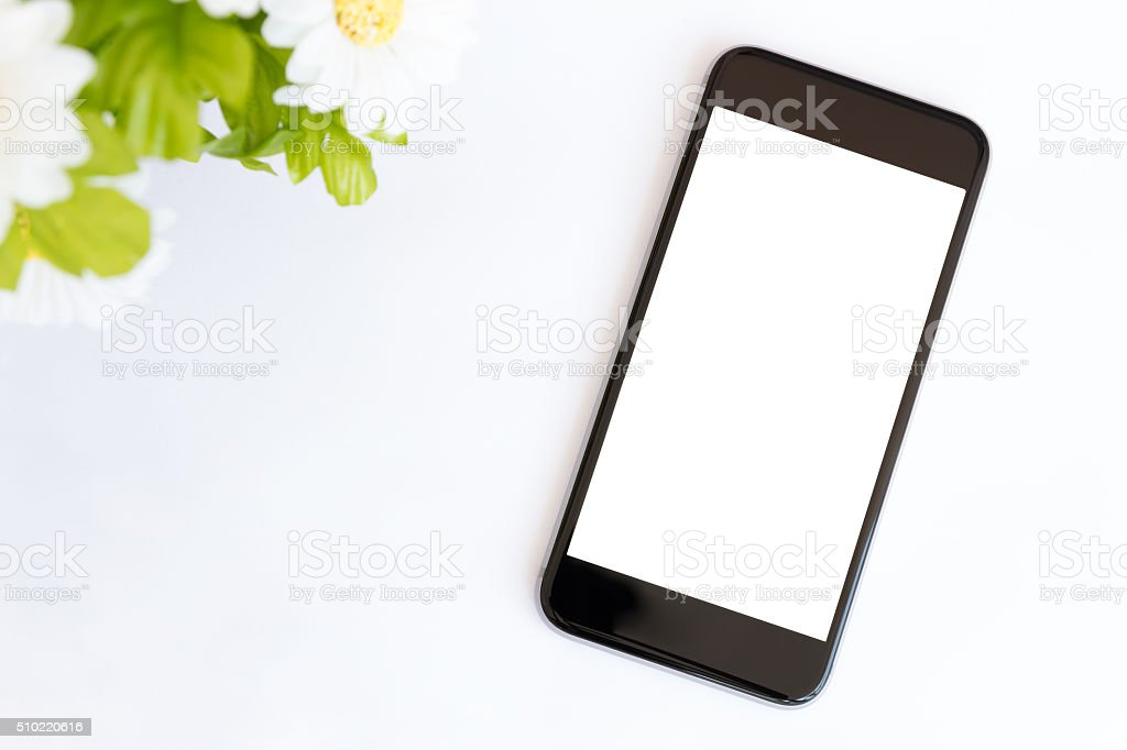smart phone white screen on white desk stock photo
