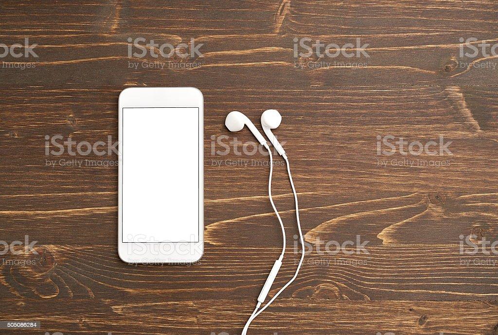 Smart phone with headphones stock photo