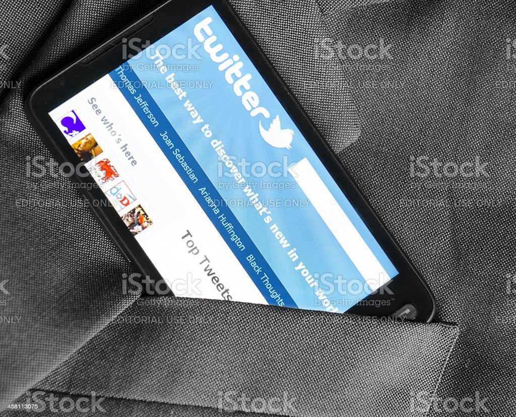 Smart phone with Twitter application in the pocket royalty-free stock photo