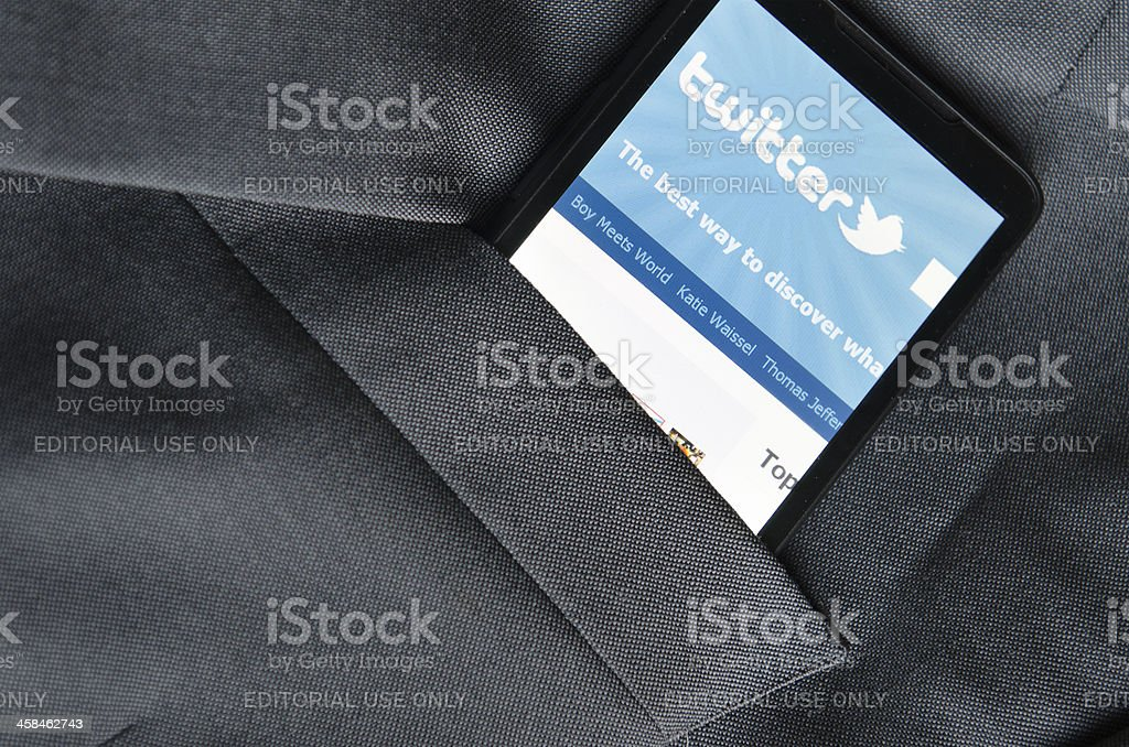 Smart phone with Twitter application in the pocket stock photo
