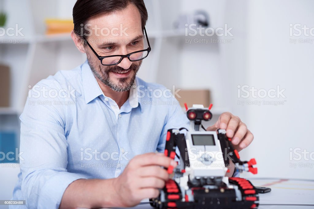 Smart scientist working on a robot production stock photo