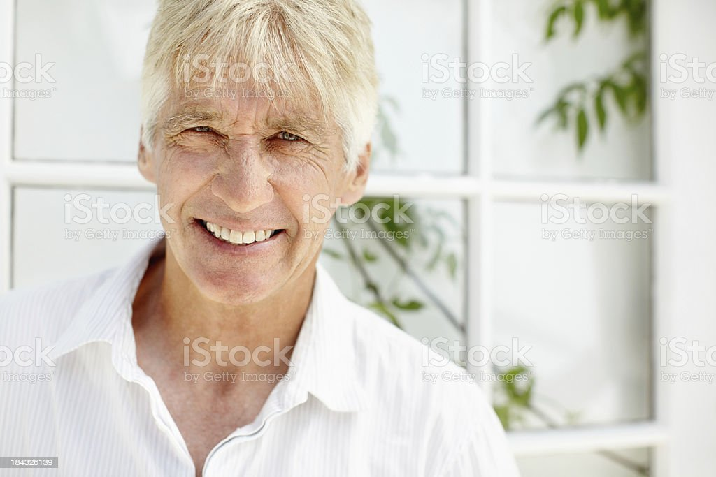 Smart, senior man smiling stock photo