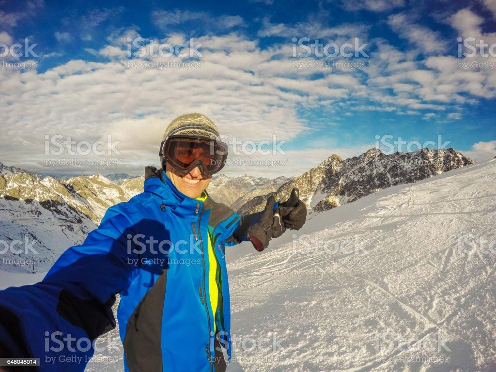 Smart snowboarder with snowgoggles in Sölden, Austria stock photo