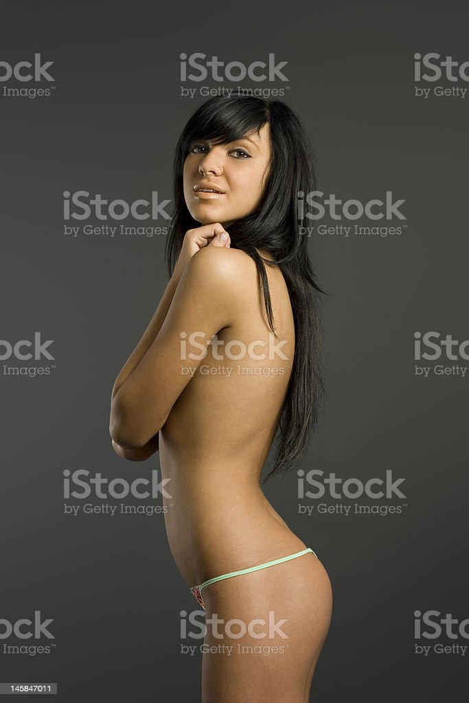 Smart topless brunette royalty-free stock photo