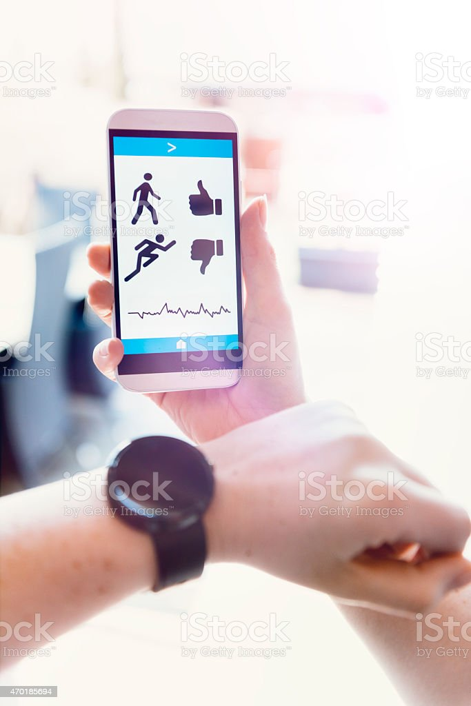 Smart watch and mobile phone with app tracks activity stock photo