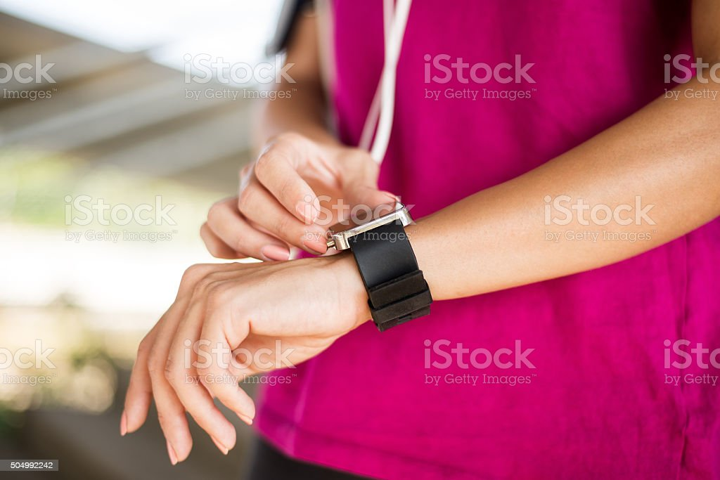 Smart watch on female arm stock photo