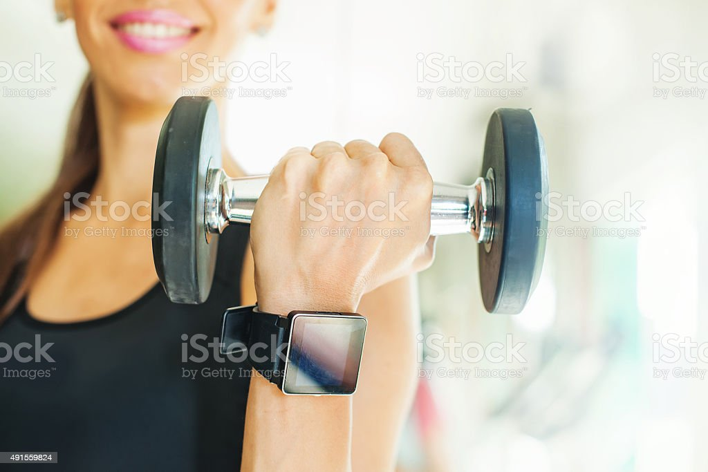 Smart watch on women hand in gym stock photo