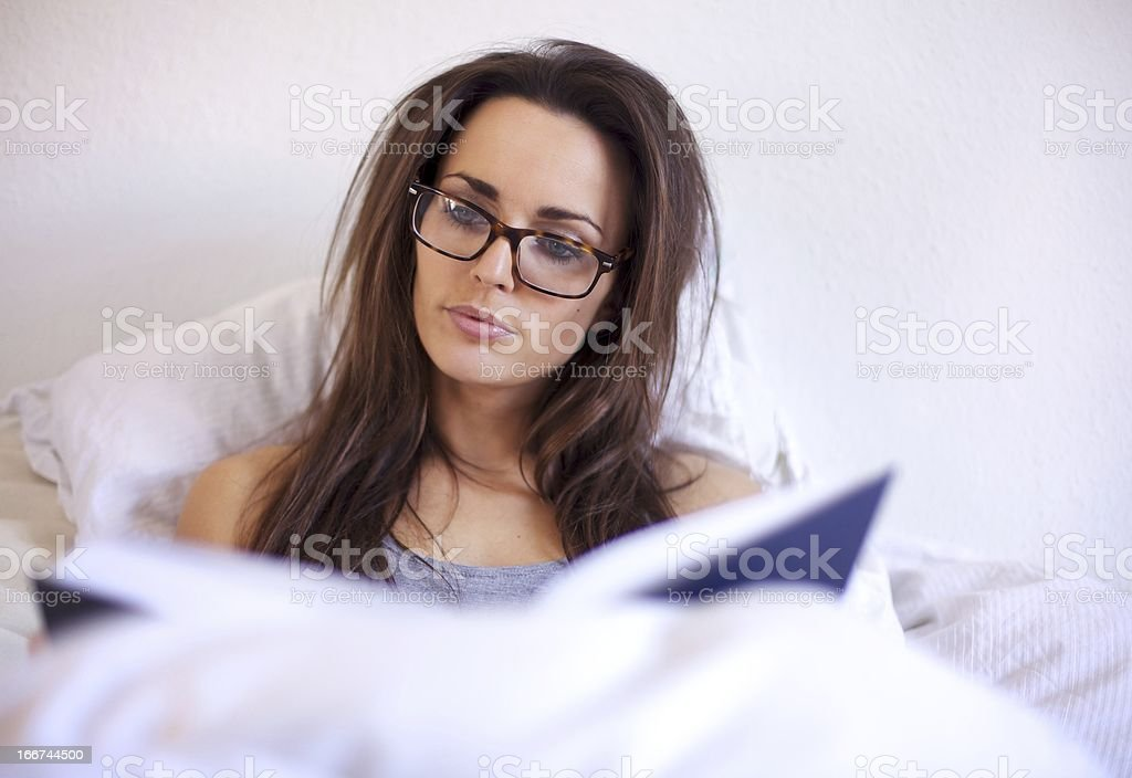 Smart Woman Enjoying Reading a Book royalty-free stock photo