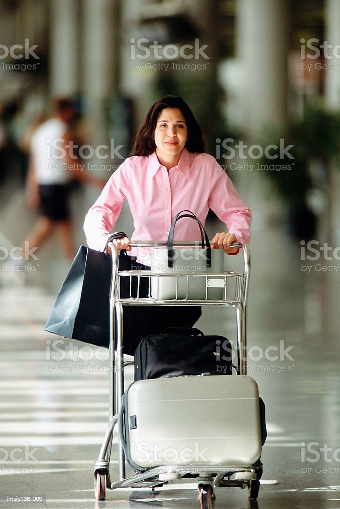 Smart woman with trolley stock photo