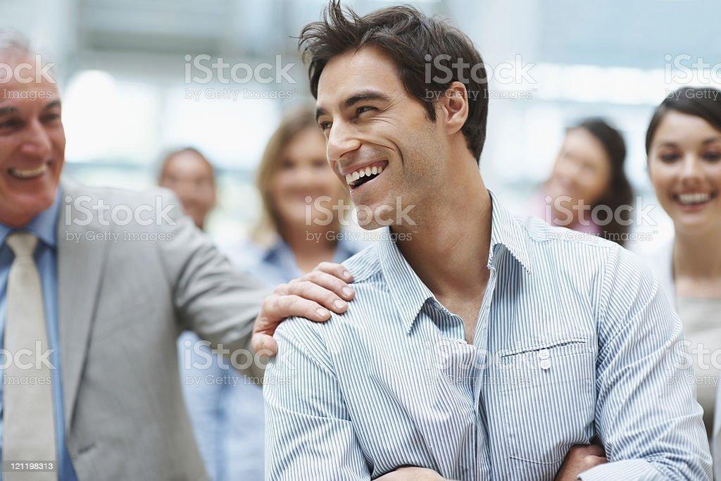 Smart young business executive enjoying success with team mates stock photo
