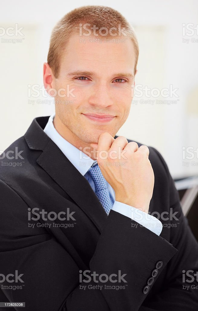 Smart young business man in black suit stock photo