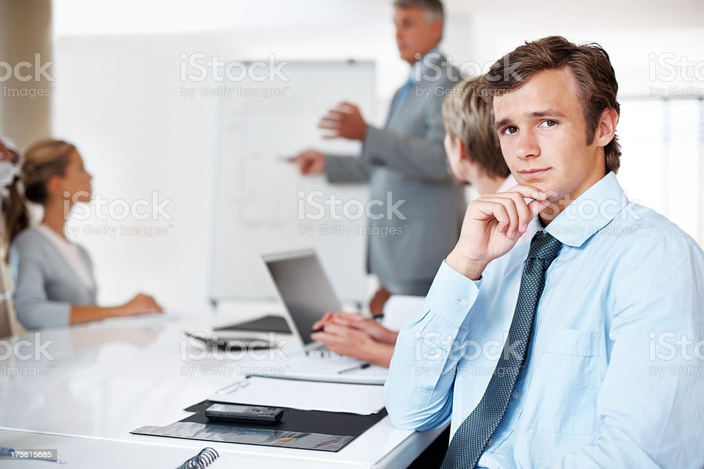 Smart young businessman looking with an attitude stock photo