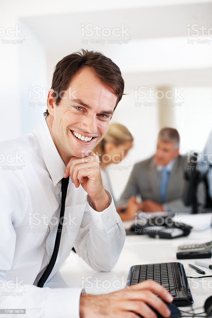 Smart young businessman working on computer at office stock photo