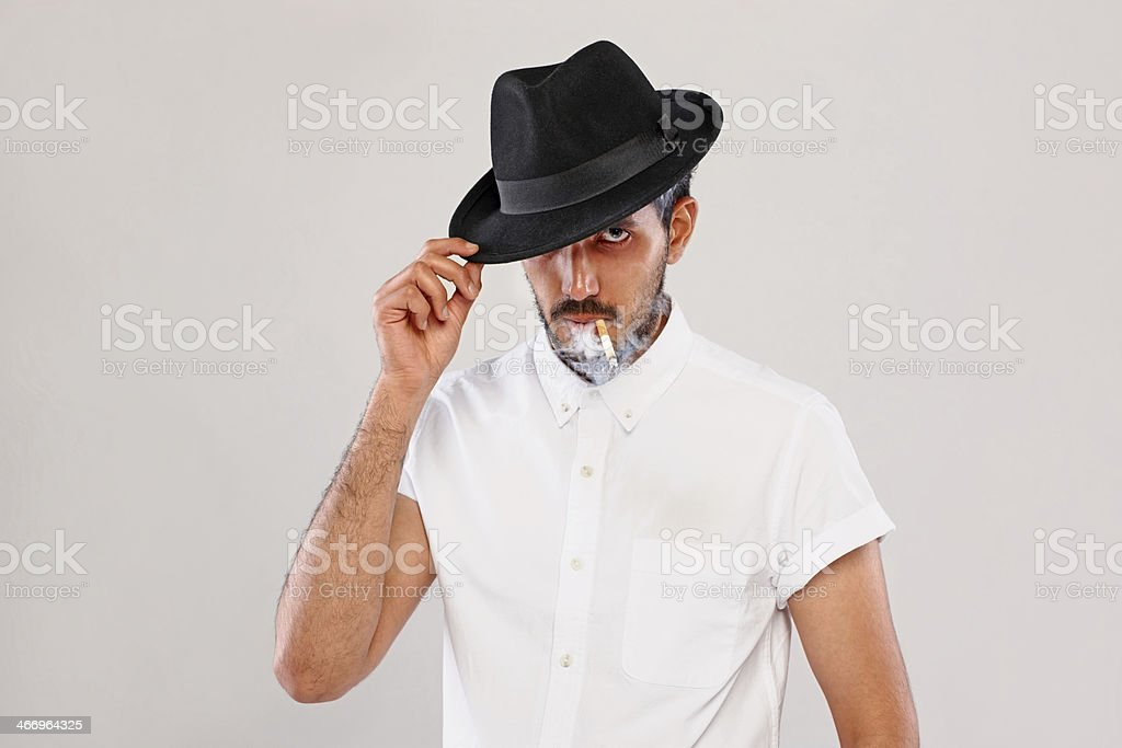 Smart young dude smoking cigarette royalty-free stock photo