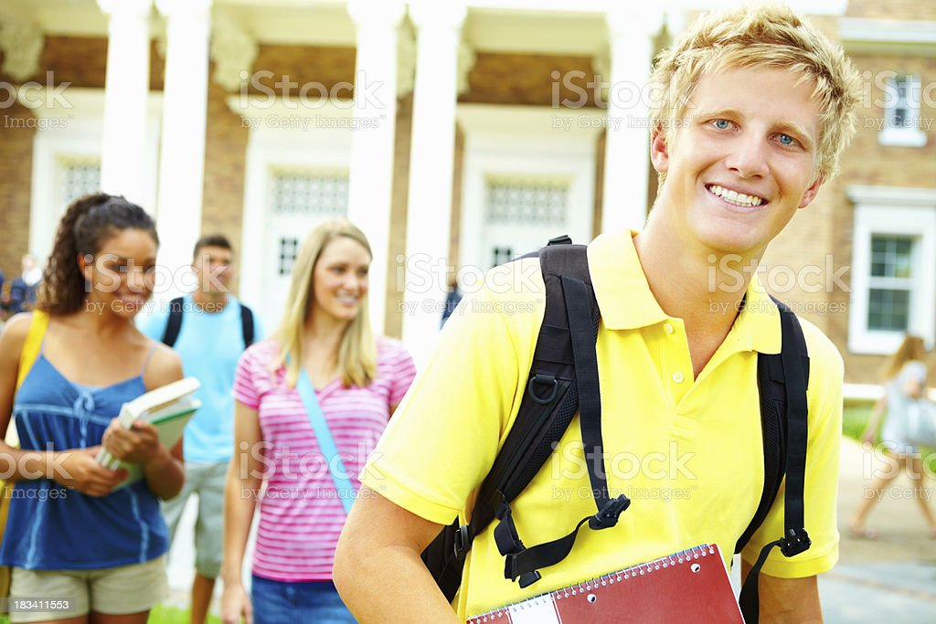 Smart, young man leaving college for the day royalty-free stock photo