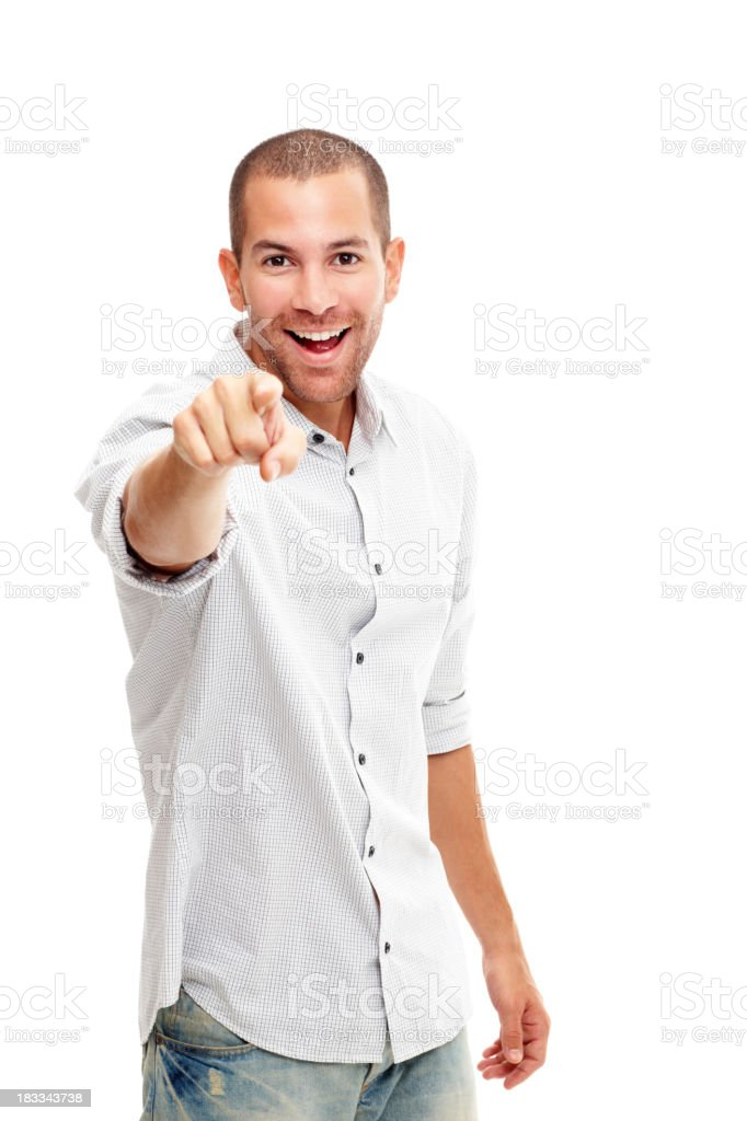 Smart young man pointing at you against white background royalty-free stock photo
