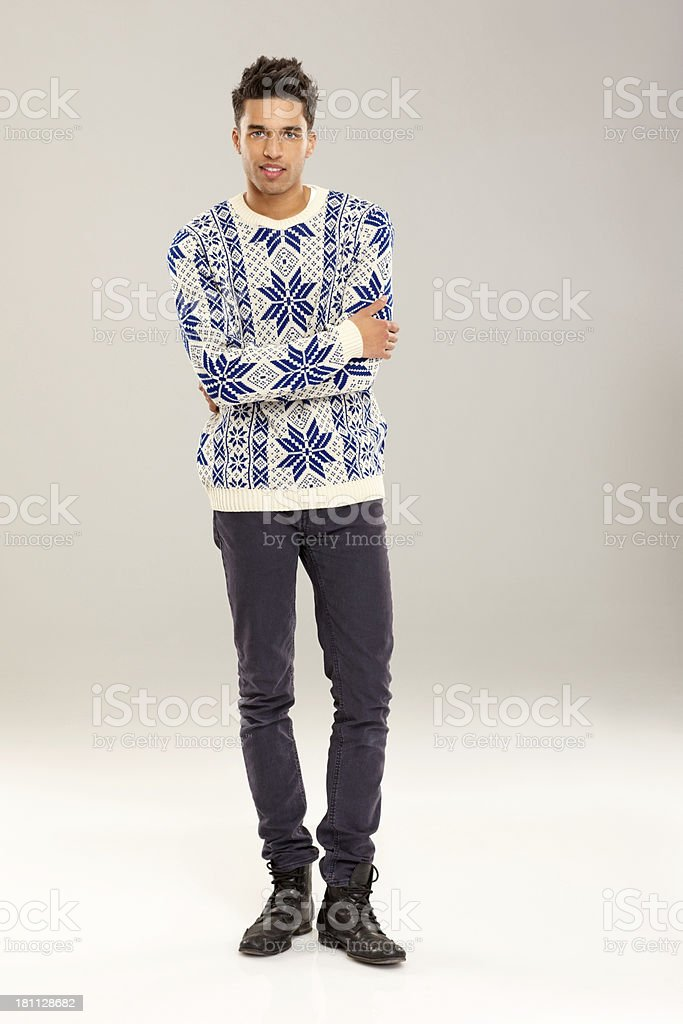 Smart young man posing on grey background royalty-free stock photo