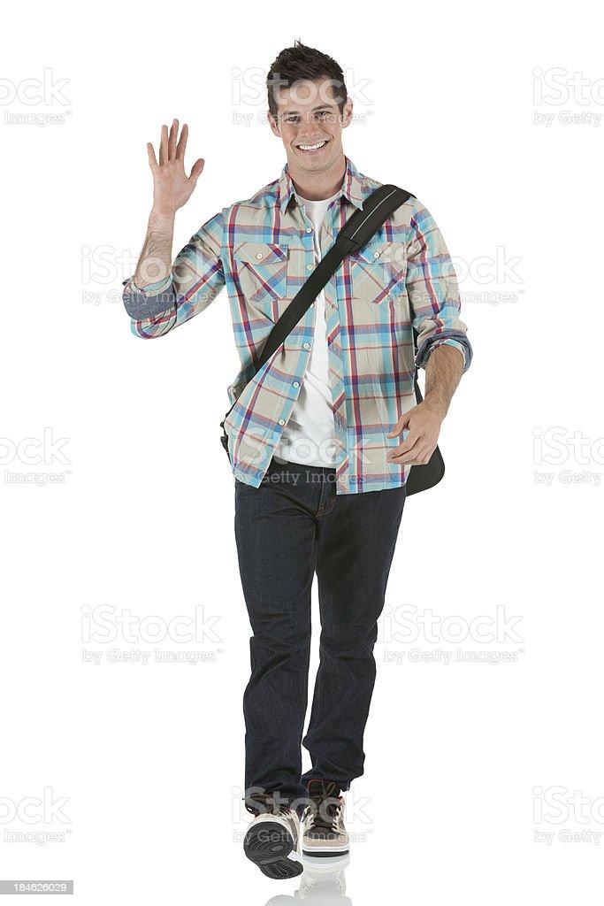 Smart young man waving his hand stock photo
