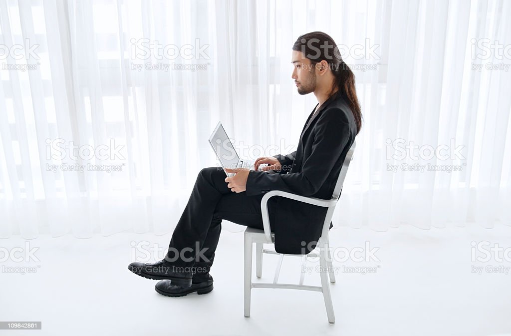 Smart young man with laptop royalty-free stock photo