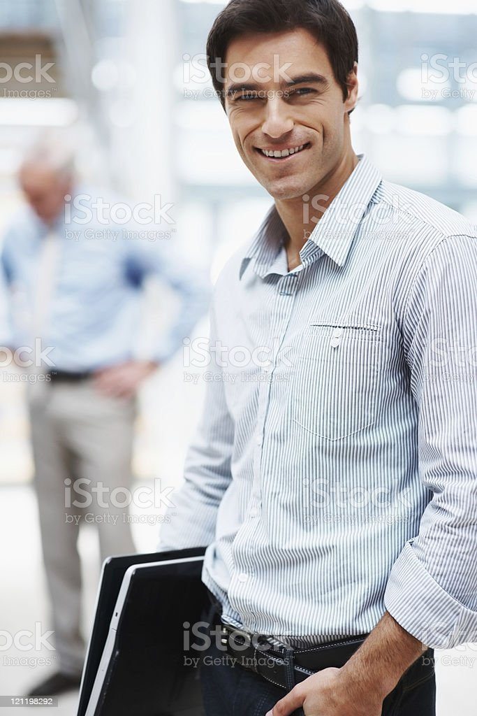 Smart  young professional with colleague in the background royalty-free stock photo
