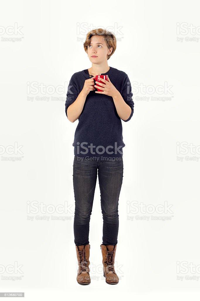 Smart Young Woman Thinking, Holding Mug. stock photo