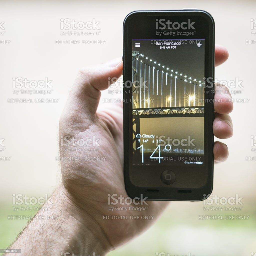 smarthphone Iphone 5 with yahoo weather app royalty-free stock photo