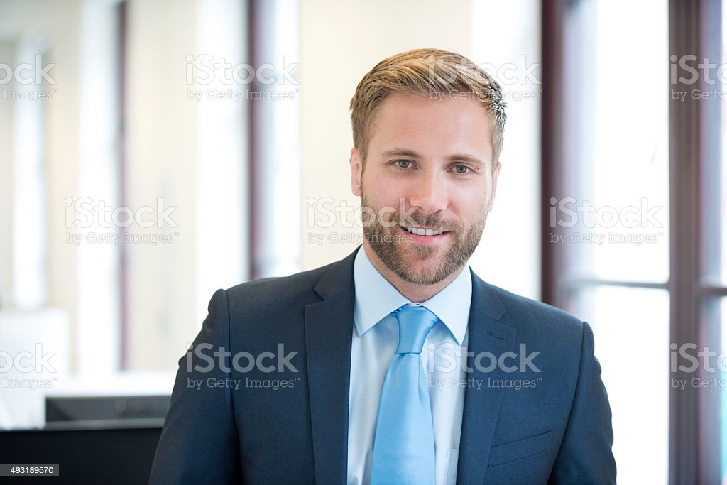 Smartly dressed businessman portrait stock photo