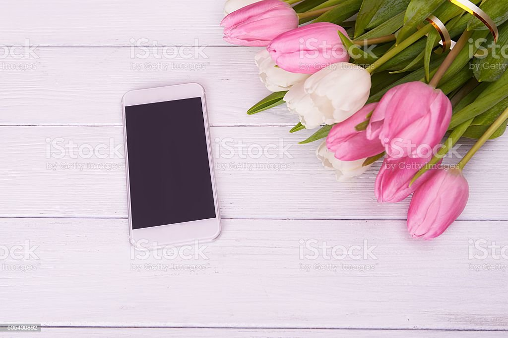 smartphon and spring tulips stock photo