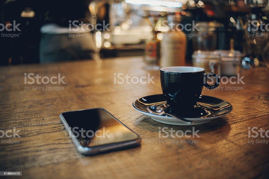 Smartphone and coffee stock photo