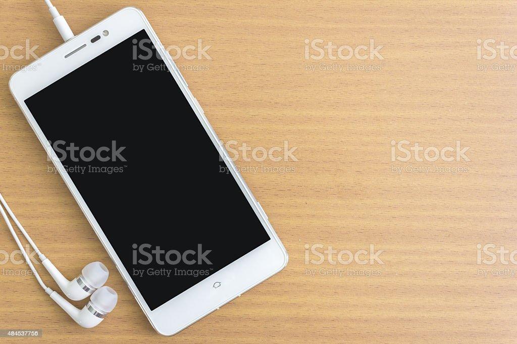 smartphone and earphone stock photo