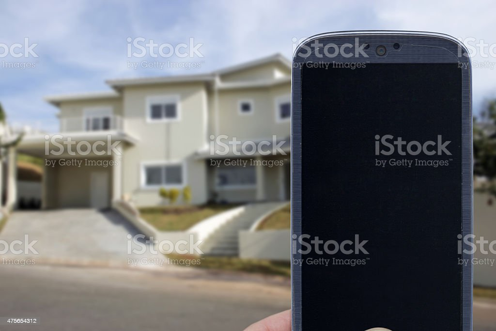 Smartphone and home connection stock photo