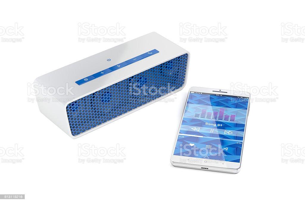Smartphone and portable speaker stock photo