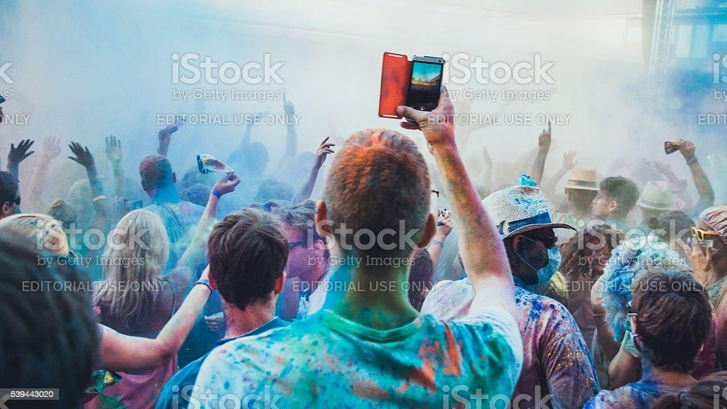 Smartphone at festival stock photo