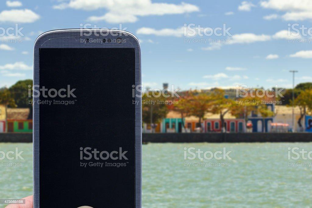 Smartphone at Porto Seguro coast stock photo