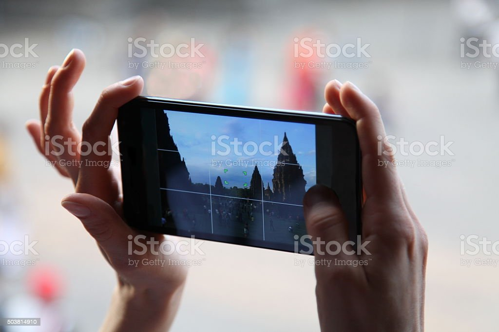 Smartphone camera in woman hands. Take photo by phone. Cellphone. stock photo