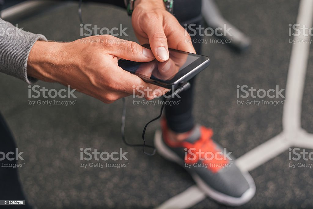 Smartphone closeup at the gym stock photo