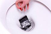 Smartphone Fallen into the Toilet Bowl
