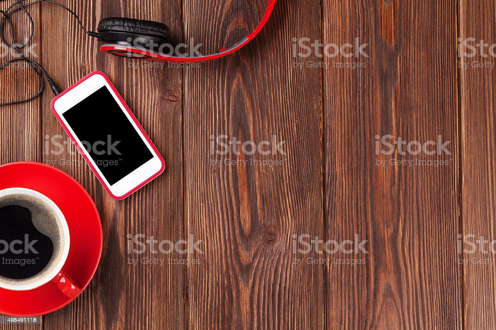 Smartphone, headphones and coffee cup stock photo