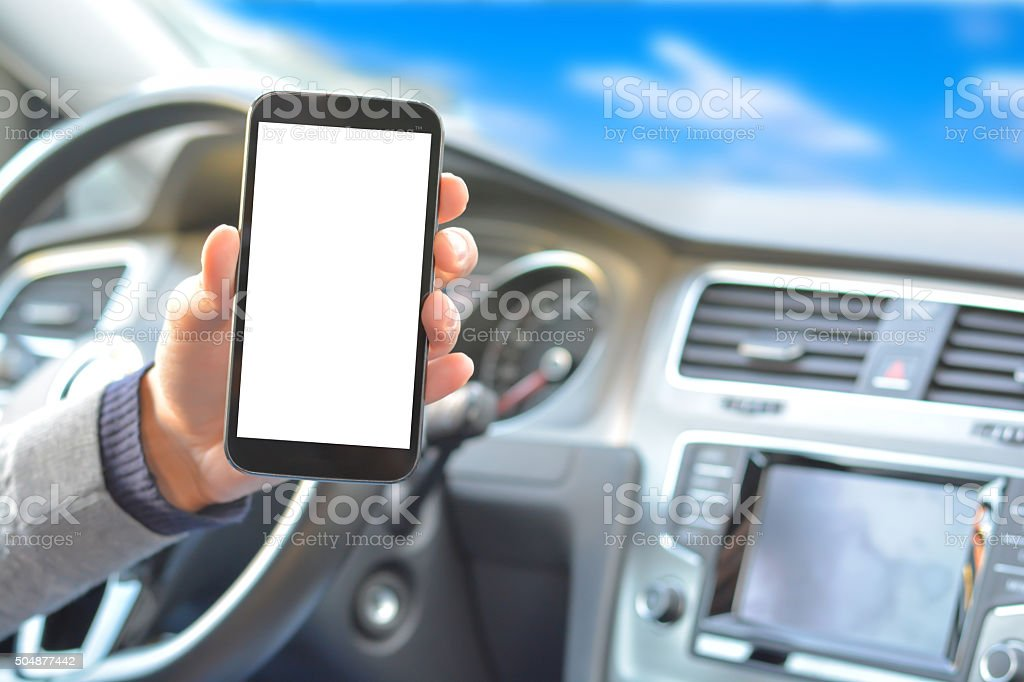 Smartphone hold by man inside a car while driving stock photo
