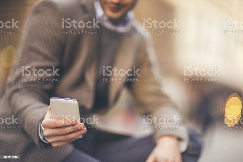 Smartphone in a man's extended hand stock photo