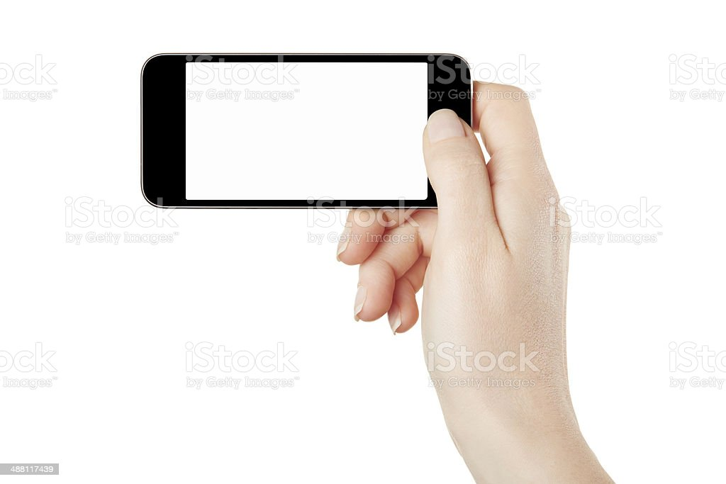 Smartphone in female hand taking photo stock photo
