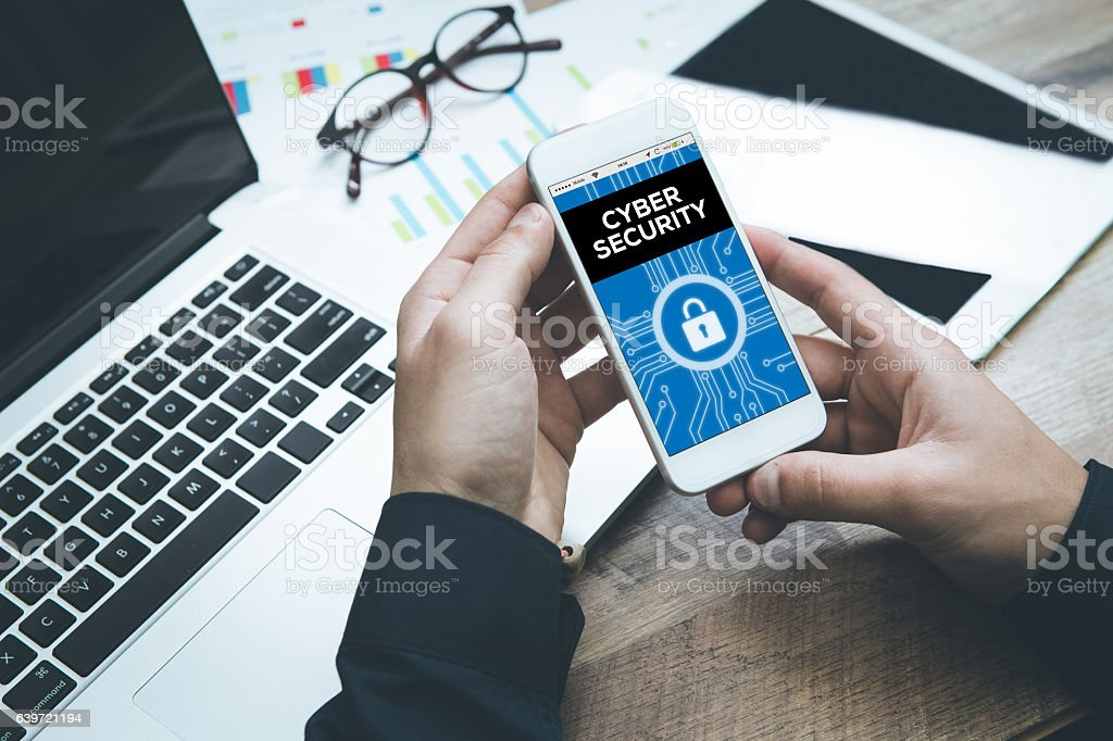 Smartphone in hand and showing Cyber Security concept on screen stock photo