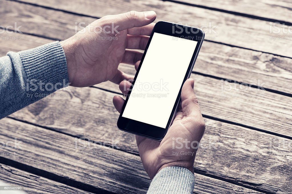 Smartphone in hands. Clipping path included. stock photo