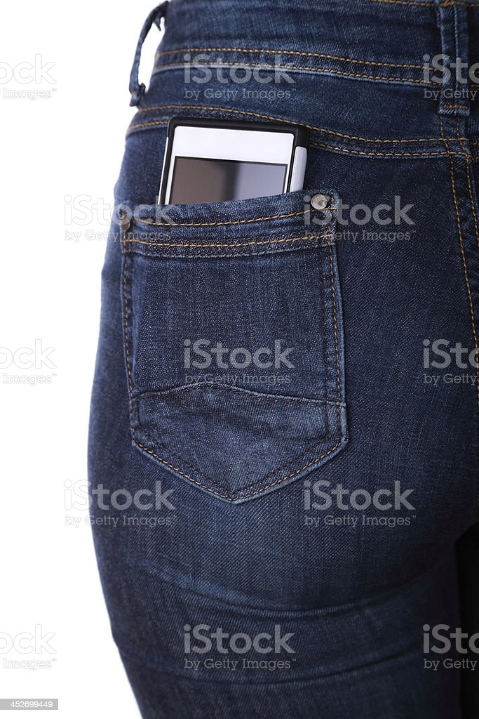 Smartphone in her back pocket stock photo
