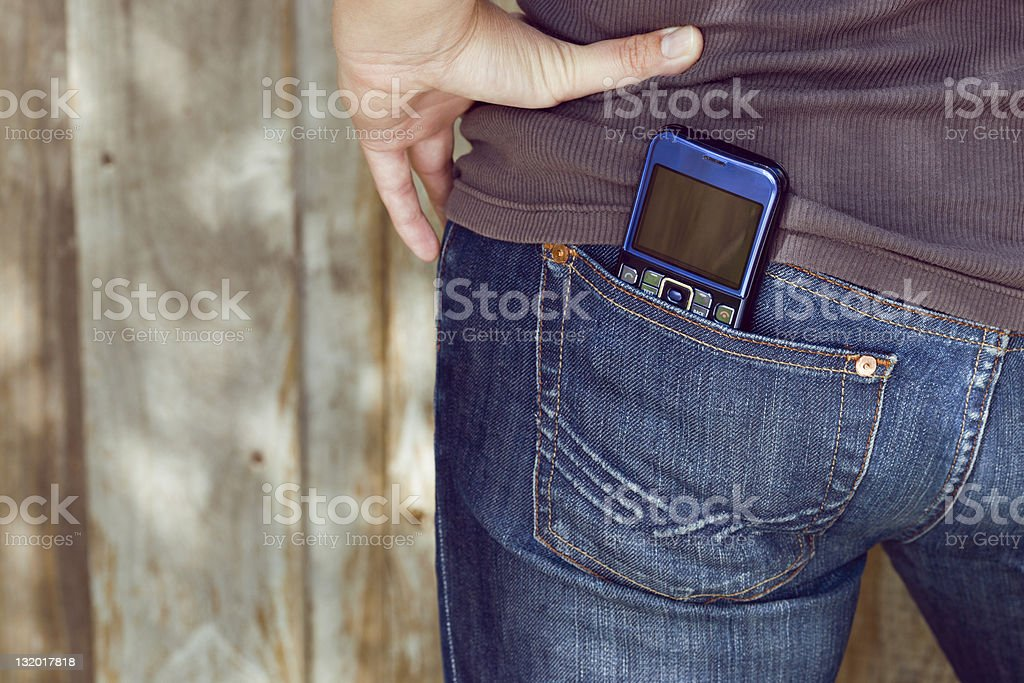 Smartphone in jeans pocket, copy space stock photo