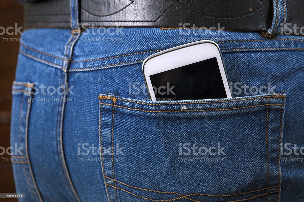 Smartphone jeans pocket stock photo